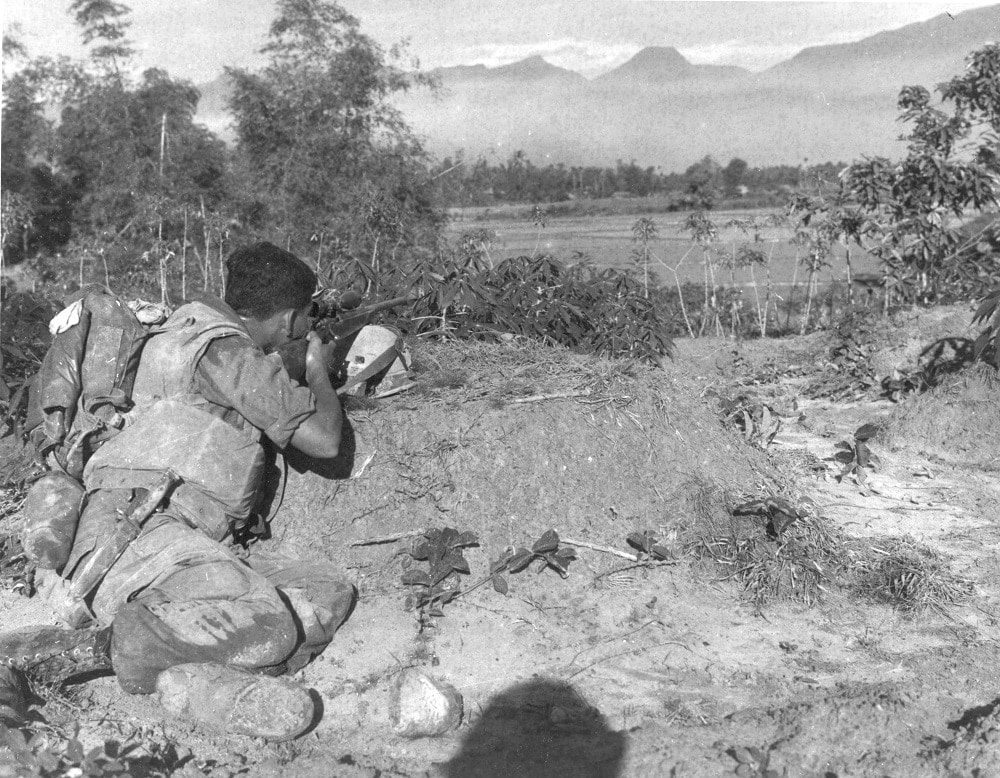 """A sniper of E Co. Second Battalion, Seventh Regiment attached to First Platoon zeros in on a Viet Cong during Operation Arizona 25 miles Southeast of Da Nang. June 20 1967."" (Photo/caption: U.S. Marine Corps History Division)"