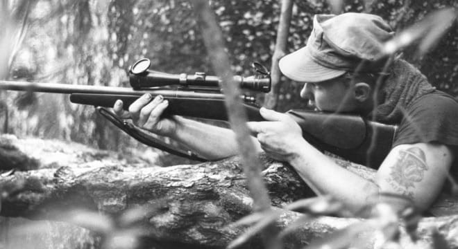 """Cpl. John Baron aims in on target on an operation in the Que Son Mountains. March 30 1970."" (Photo/caption: U.S. Marine Corps History Division)"