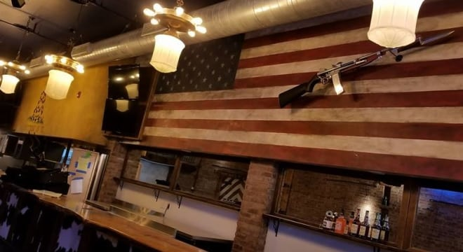 The decor at the Eagle Saloon includes what looks to be a vintage M1 Carbine training device and a Gadsden flag. (Photo: The Eagle Saloon)
