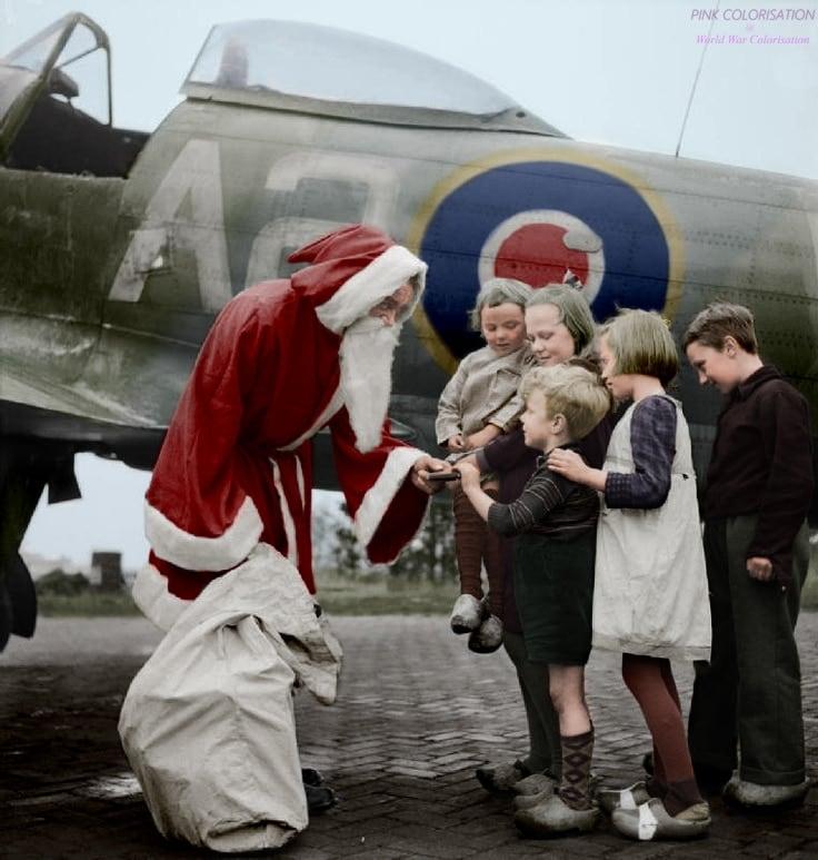 British RAF Hawker Tempest Mk.V W2-A (NV700) based at B.70 Volkel Air Base near Uden, Netherlands, bringing Santa Claus to the kids, 1944