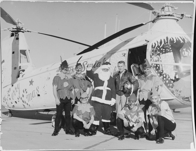 """""""Santa and elves arrive by special helicopter for a children's Christmas party at Naval Air Station Oakland, 23 December 1956."""" (Photo: U.S. Navy)"""