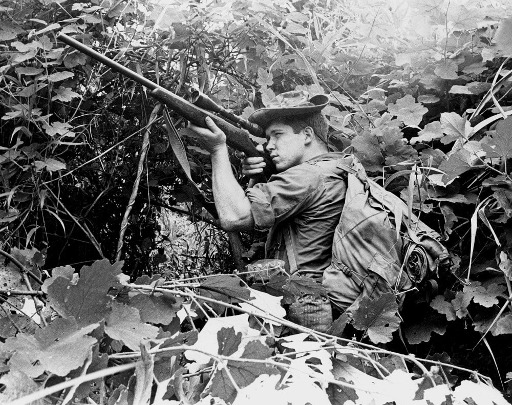 """Lance Cpl. Robert B. Moore sights in on an enemy soldier. October 9 1968"" (Photo/caption: U.S. Marine Corps History Division)"