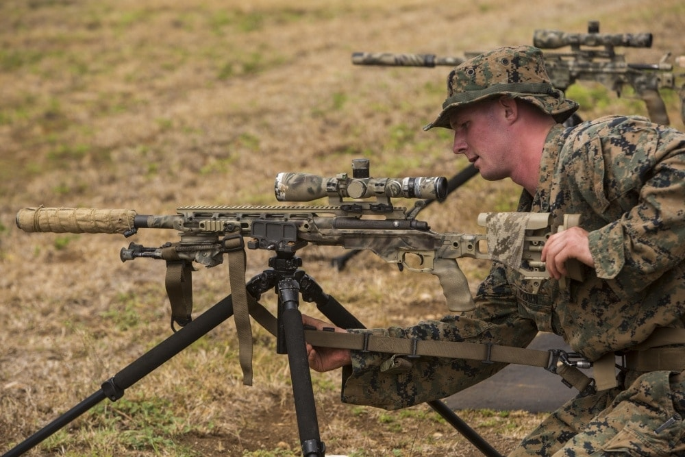 Lance Cpl. William Pearn, a scout sniper candidate with Weapons Company, 2nd Battalion, 3rd Marine Regiment, secures a strap to an M40A6 sniper rifle during a pre-scout sniper course at Pu'uloa Range Training Facility aboard Marine Corps Base Hawaii, August 14, 2017. (Photo: DoD)