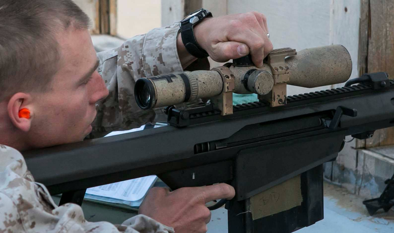 Marine scout sniper with the Battalion Landing Team 2 6, 26th Marine Expeditionary Unit (MEU), makes changes to the scope on his M107 Special Application Sniper Rifle (Photo: DoD)