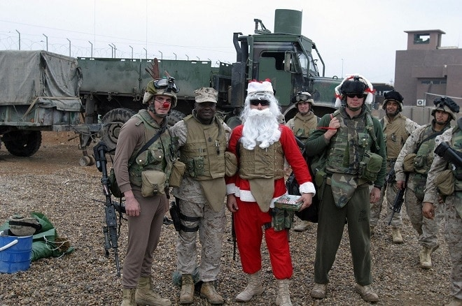 Santa Claus, Mrs. Claus and Rudolph the red-nosed reindeer on Snake Pit, Ar Ramadi, Al Anbar Province, Iraq with 1st Division Marines 2004 (Photo: National Archives)
