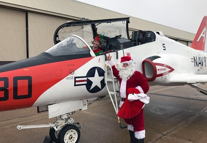 Santa Claus and an elf get out of a T-45C Goshawk during a visit to Training Air Wing One at Meridian NAS for a children's Christmas party (Photo: U.S. Navy)