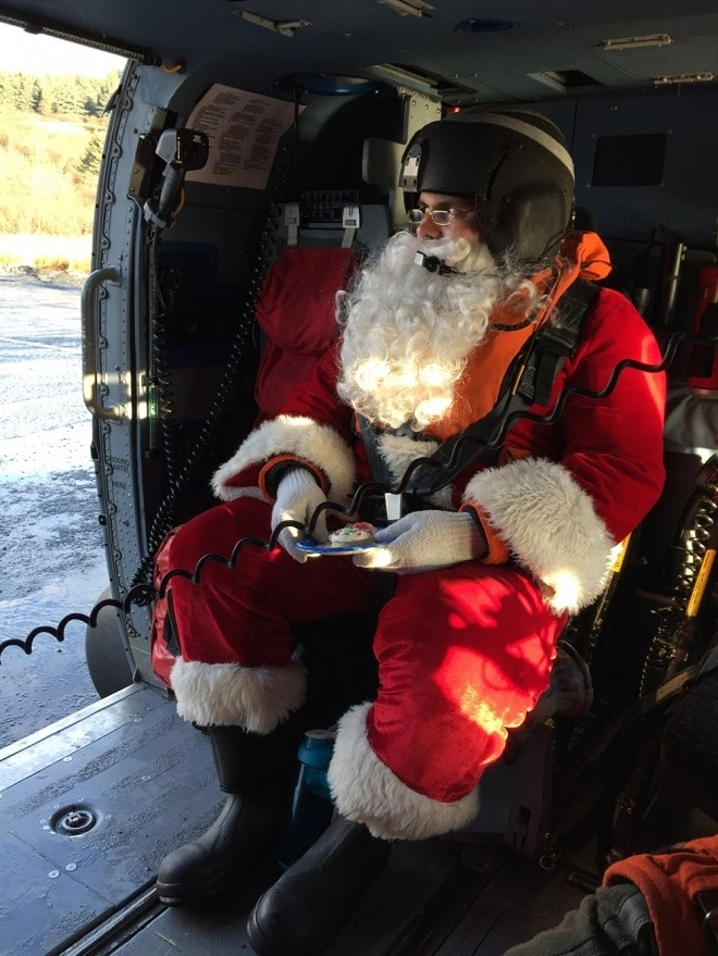Santa Claus waits in a Coast Guard Air Station Kodiak MH-60 Jayhawk helicopter to take off to take him to the next remote Kodiak Island, Alaska, village, Dec. 5, 2017 (Photo: USCG)