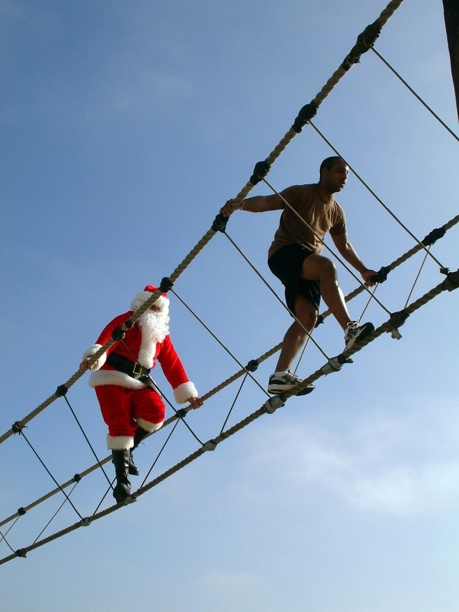 To keep in shape, here's Santa on the Naval Special Warfare Center's obstacle course, during the Santa Mash 2, annual duathlon competition held at Naval Base Coronado, Calif., in 2006. (Photo: National Archives)