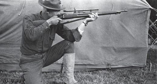 US Marine firing the USMC Telescopic Rifle, Model of 1917 which is a M1903 1903 with a Winchester A5 scope. (NARA)