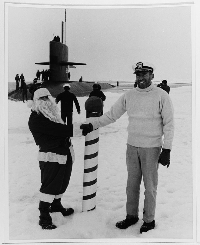 """USS QUEENFISH (SSN-651) Caption, """"Surfaced at the North Pole, August 1970. Chief Quartermaster Jack Patterson, dressed as Santa Claus, greets Commander Alfred S. McLaren, USN, Commanding Officer"""" (Photo: U.S. Navy)"""