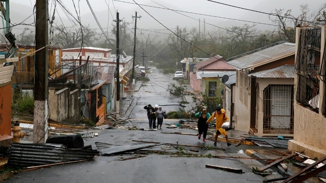 The lingering impacts of Hurricane Maria plague Puerto Rico three months later. (Photo: Carlos Garcia Rawlins/Reuters)