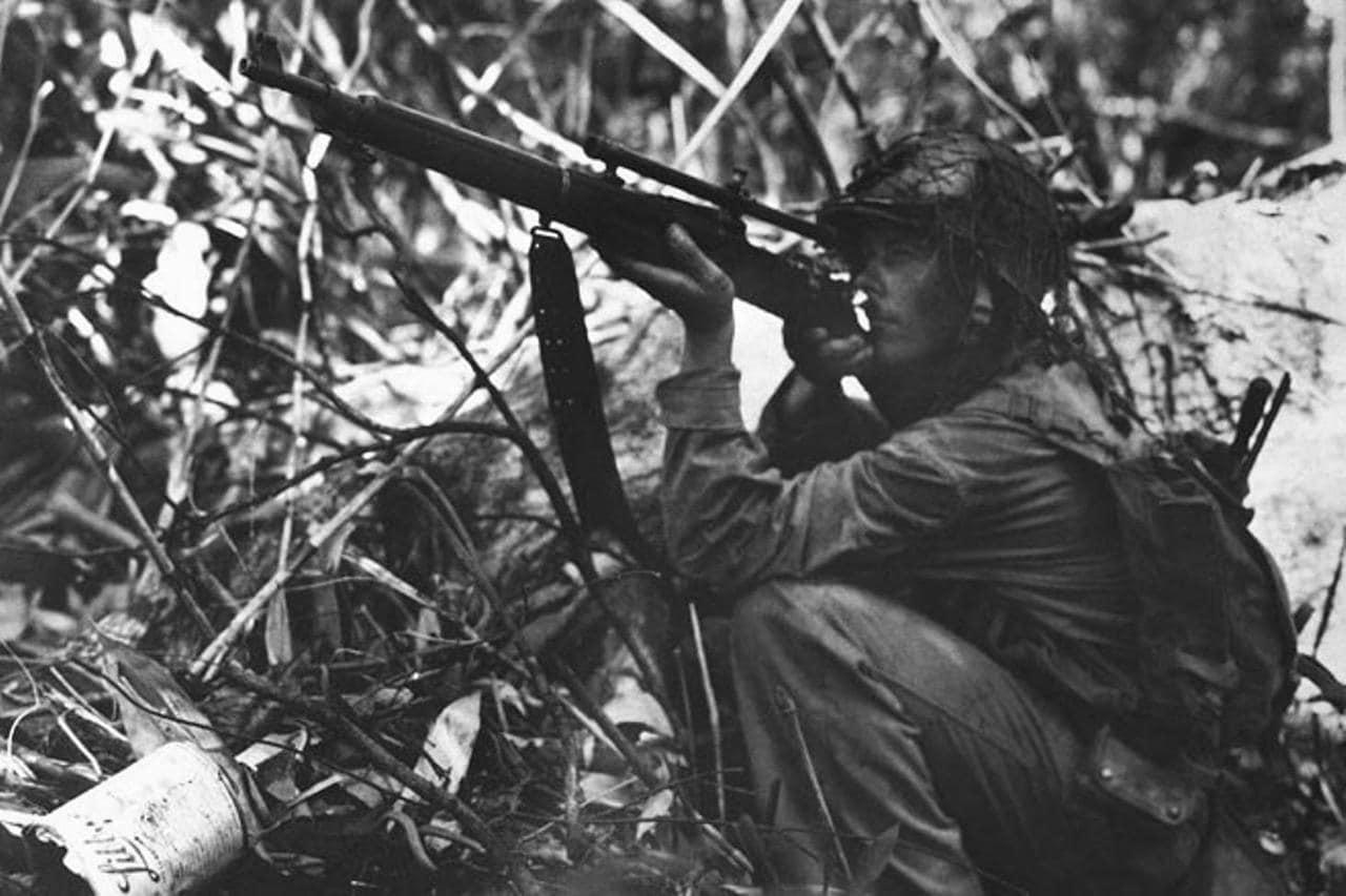 springfield 1903 sniper rifle US Marine Sniper in Guadalcanal, November 1942.
