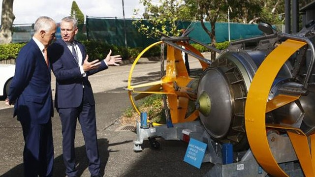 Prime Minister Malcolm Turnbull and Thales CEO Chris Jenkins at Thales Underwater Systems in Sydney today. Mr Turnbull has unveiled a plan to become one of the world's top 10 exporters of military hardware. (Photo: Daniel Munoz/AAP)