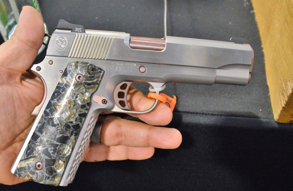 This stainless version of Nighhawk Custom's Lady Hawk 2.0 includes custom grips composed of Obsidian, Abalone, and Zinc