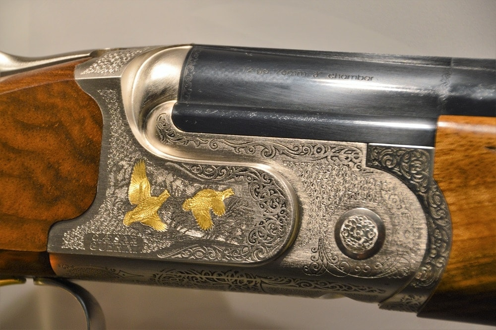 Italian shotgun maker Caesar Guerini had so many extensively engraved locks on their over and unders that it was hard to pick just a few to examine.