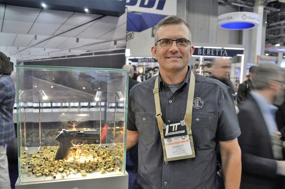 """How much is 50,000 rounds? """"It's multiple lifetimes of ammo,"""" says Langdon, shown here with his pistol. """"A hundred years' worth."""" (Photo: Chris Eger/Guns.com)"""