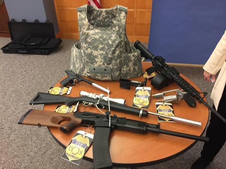 Some of the firearms seized during a recent sweep on display at a Thursday afternoon, Jan. 25 news conference at the federal courthouse in Fresno include a Saiga semiautomatic shotgun and an AR-style rifle with drum magazines. (Photo: Jim Guy/ Fresno Bee)