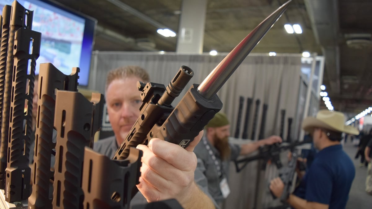 Peter Kennedy, part owner of Paper City Firearms, demonstrates how to use The Stinger, a new take on the bayonet, at SHOT Show 2018 in Las Vegas. (Photo: Daniel Terrill/Guns.com)