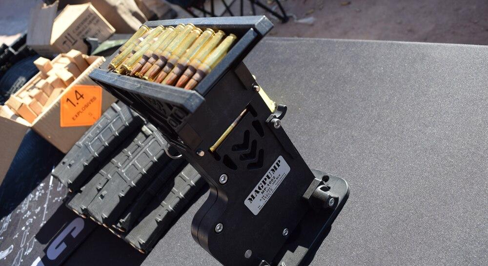 "A ""Magpump"" ammo feeder feeding 5.56 rounds into AR mags. (Photo: Daniel Terrill/Guns.com)"