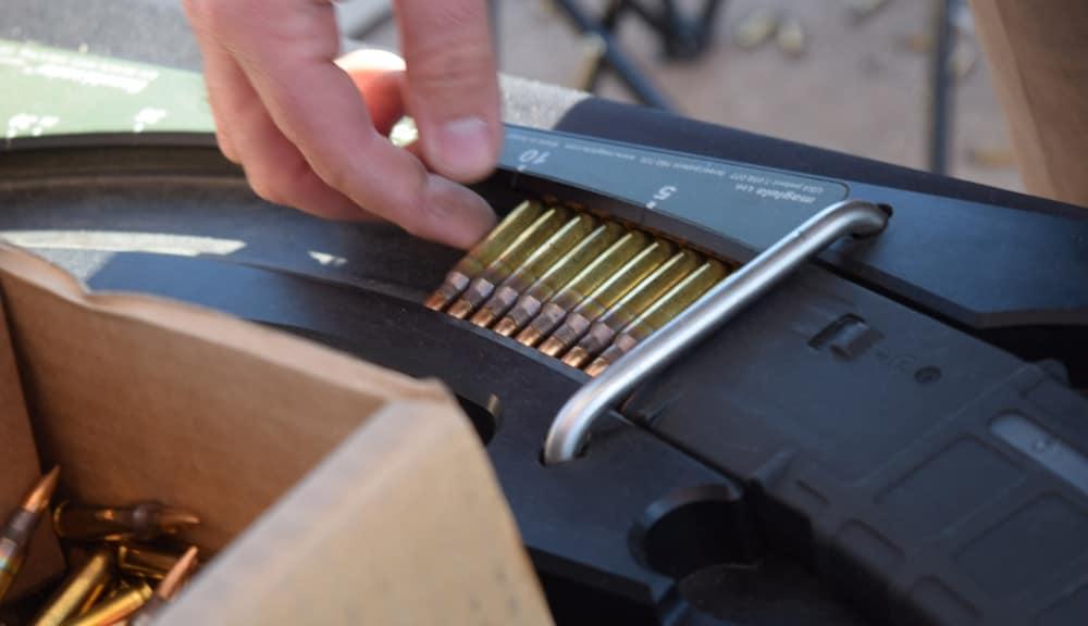 A Maglula feeding device cramming 5.56 rounds into an AR magazine. (Photo: Daniel Terrill/Guns.com)