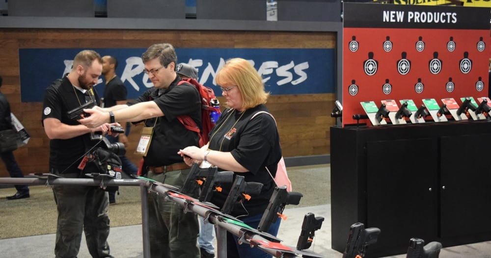 Can you guess where the new products are at the Crimson Trace booth? (Photo: Daniel Terrill/Guns.com)