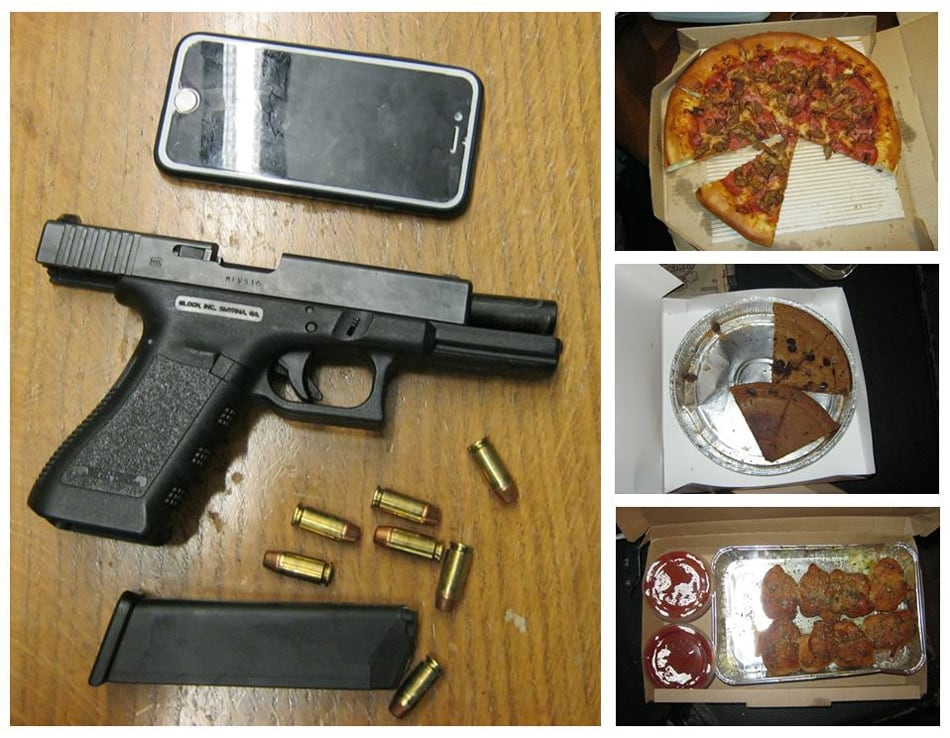 A .40-caliber Glock pistol next to a cell phone, a meat lover's pizza, cookie pie, and bread sticks. (Photo: Pierce Sheriff's Dept/Facebook)