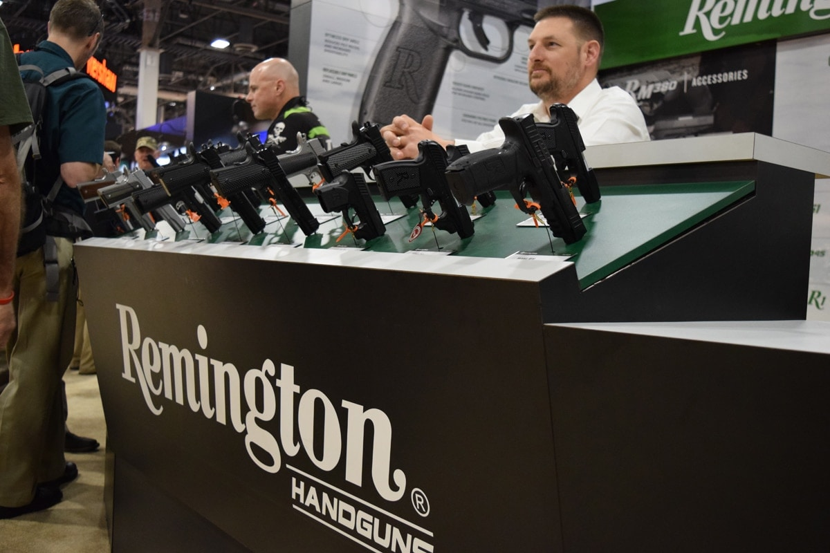 A Remington representative waits patiently behind the handgun display for  patrons during the opening hours of SHOT Show 2018 in Las Vegas. (Photo: Daniel Terrill/Guns.com)