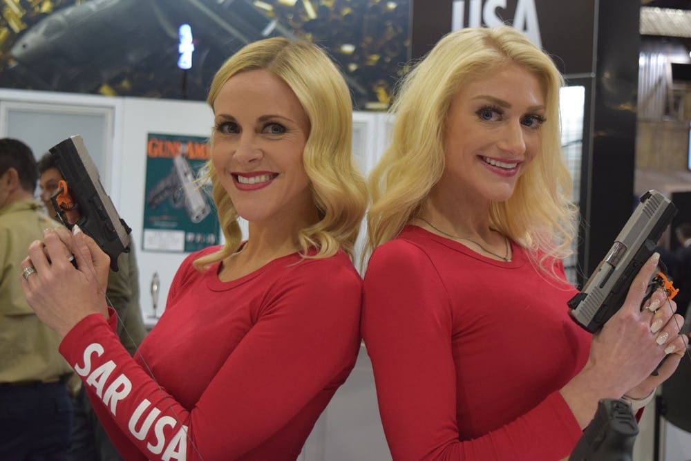 Some lovely ladies showing off their favorite pistols at the SAR USA booth. (Photo: Daniel Terrill/Guns.com)