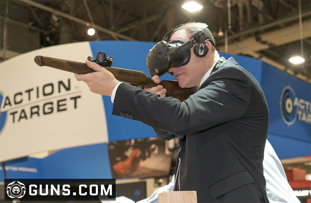 A gentleman trying out a virtual simulator at the Action Target booth. (Photo: Ben Philippi/Guns.com)