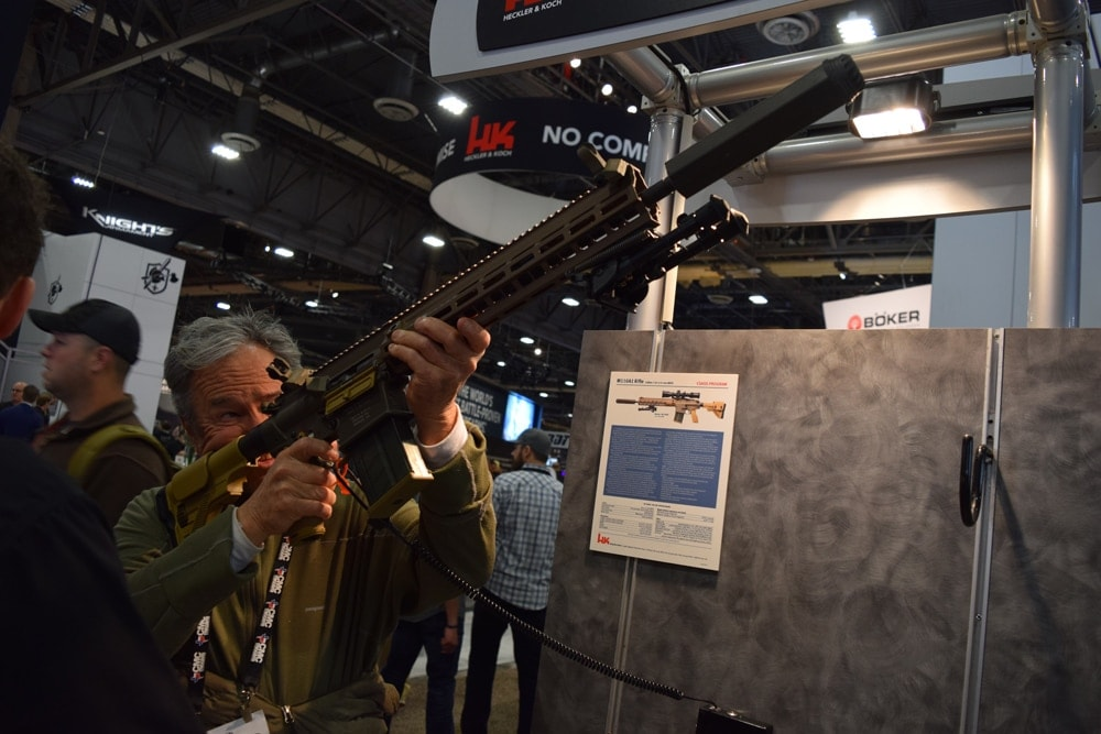 A patron scoping out the M110A1 rifle made by Heckler & Koch during SHOT Show 2018. (Photo: Daniel Terrill/Guns.com)