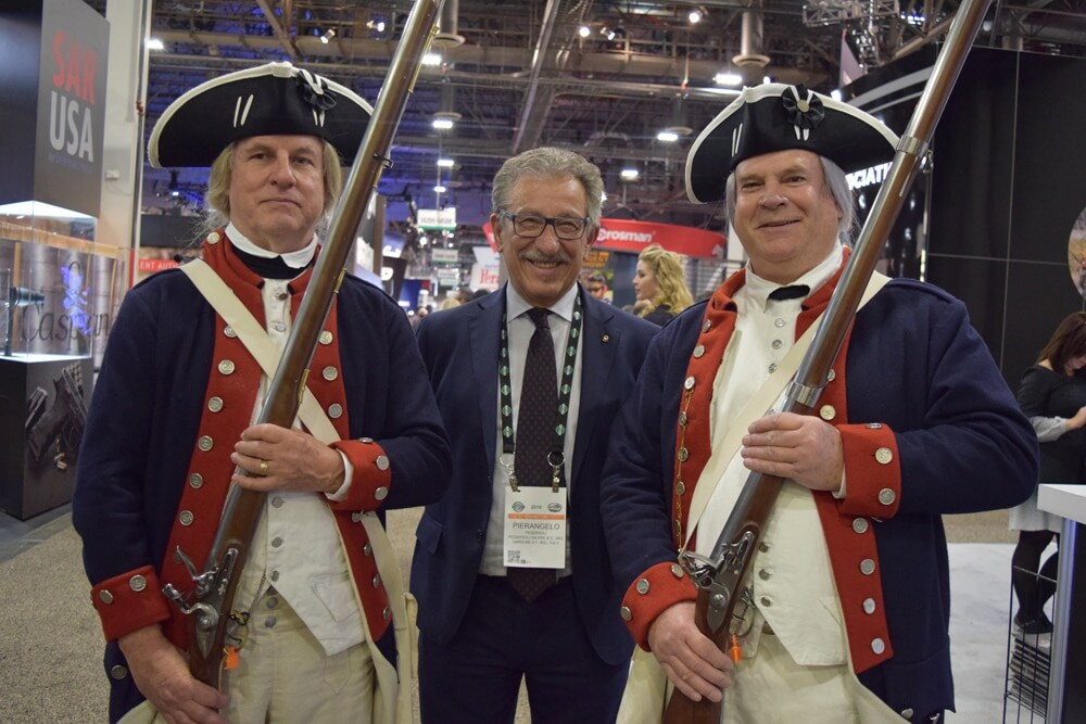 Pierangelo Pedersoli, of Pedersoli firearms, stood between his hired guns at the end of first day of SHOT Show 2018. (Photo: Daniel Terrill/Guns.com)