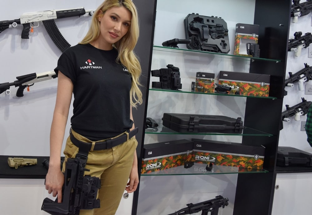 A model for CAA gear and Hartman optics at the Kalashnokov USA booth during SHOT Show 2018 in Las Vegas. (Photo: Daniel Terrill/Guns.com)
