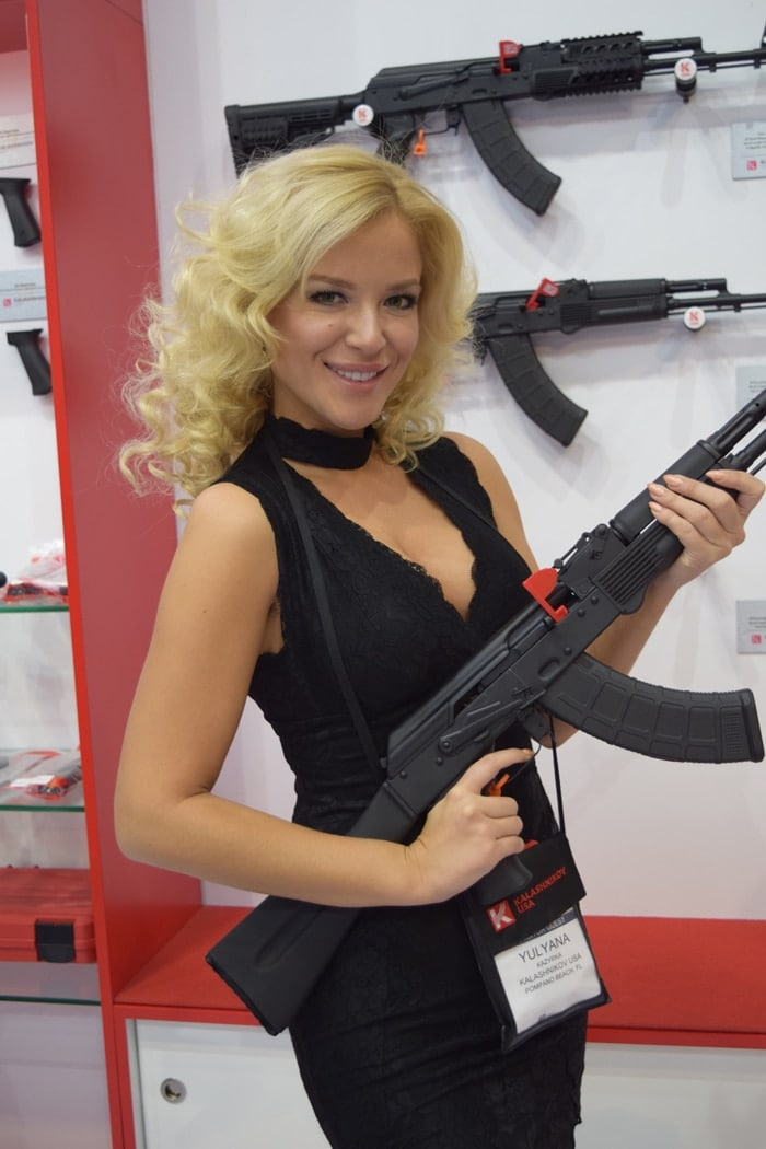 A model posing with a Kalashnikov USA rifle at the company's booth during SHOT Show 2018 in Las Vegas. (Photo: Daniel Terrill/Guns.com)