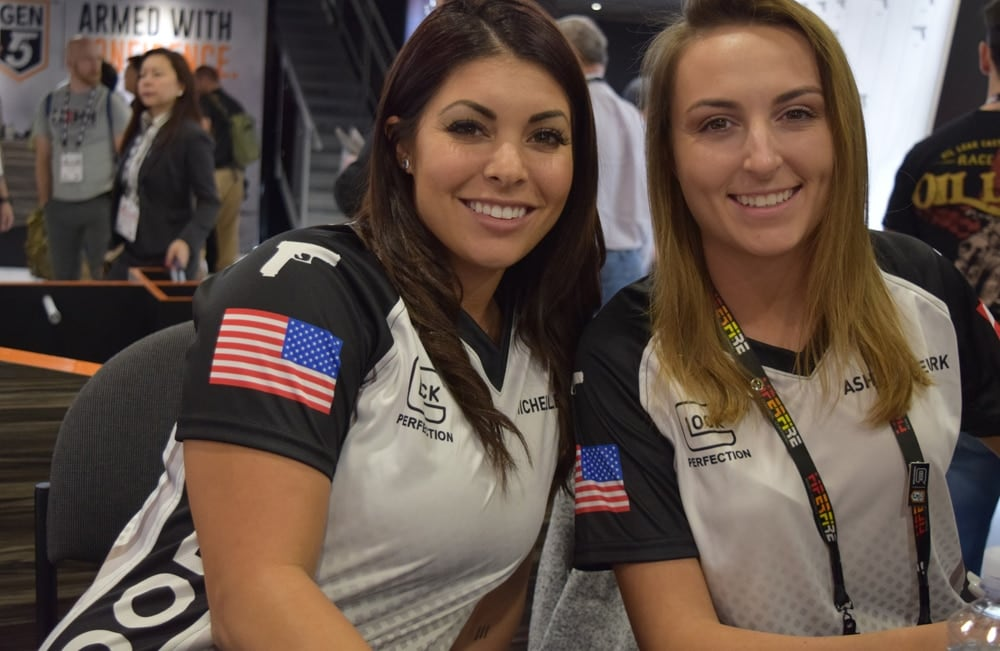 Professional shooters Michelle Viscusi, left, and Ashley Rheuark at the Glock booth during SHOT Show 2018 in Las Vegas. (Photo: Daniel Terrill/Guns.com)