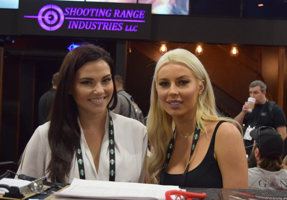 Models posing for Shooting Range Industries at SHOT Show 2018 in Las Vegas. (Photo: Daniel Terrill/Guns.com)
