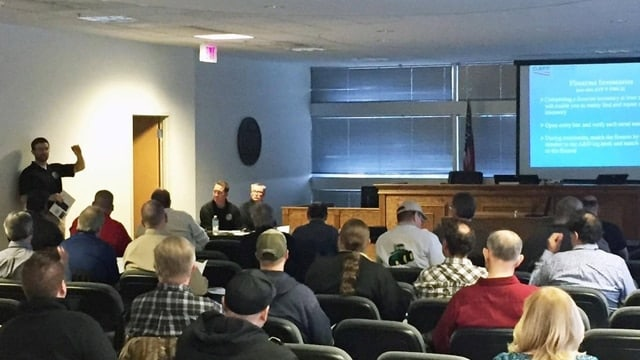 An ATF Industry Operations Investigator presents to area federal firearms licensees on methods of securing firearm inventories including installation of alarm systems and other physical security measures, as well as best practices in record keeping to ensure a good record of inventory is in place. (Photo: ATF Saint Paul Field Division)