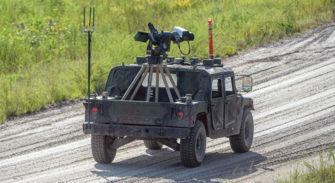 A Robotic Wingman vehicle maneuvers semiautonomously through a course at Fort Benning, Georgia, in late 2017. The vehicle can mount either a M134 Gatling-style minigun or an M240B machine gun. (Photo: U.S. Army)