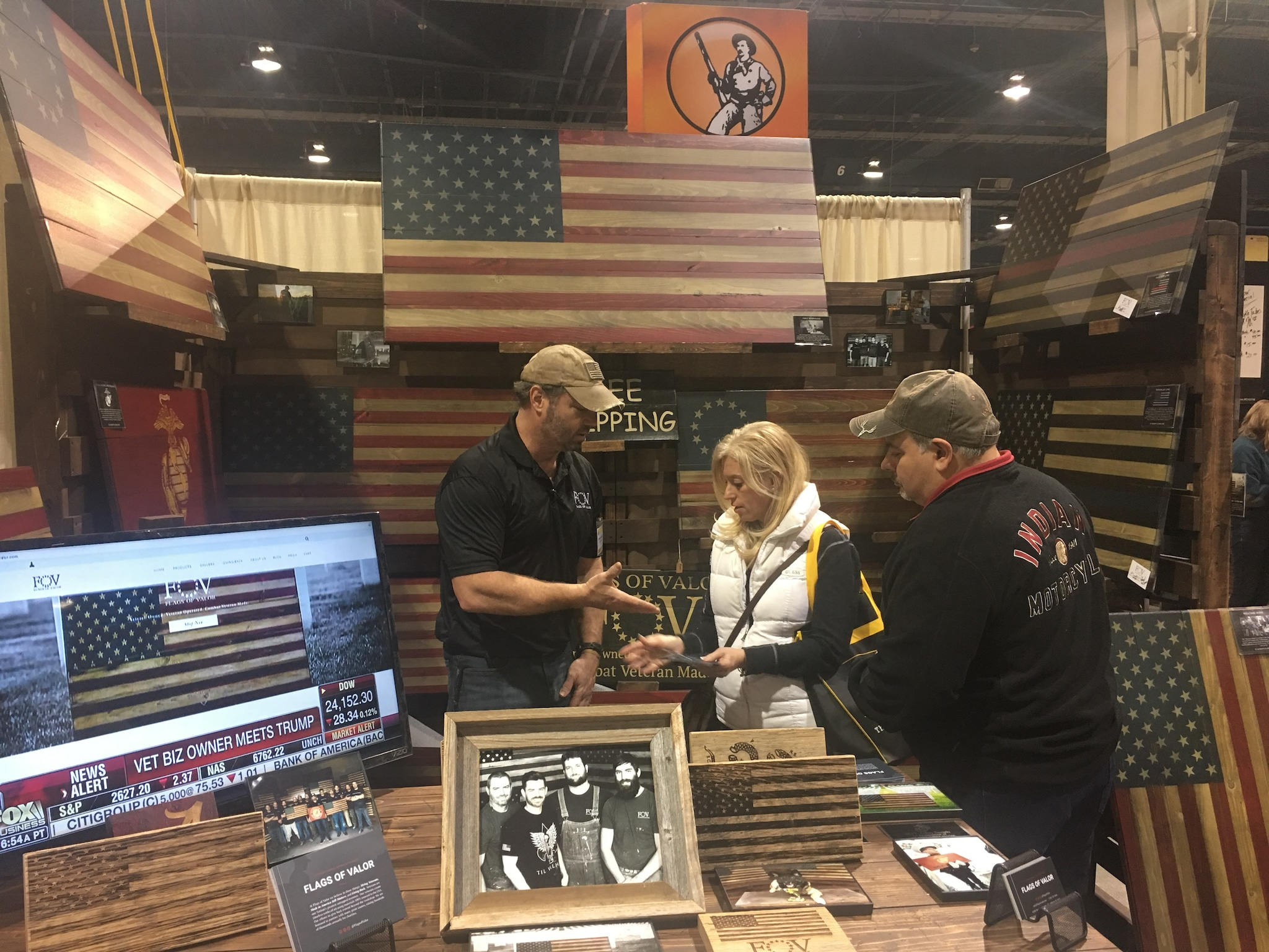 Bill Steorts, director of sales for Flags of Valor, assists customers at the 2018 Great American Outdoor Show in Harrisburg, Pennsylvania. (Photo: Christen Smith/Guns.com)