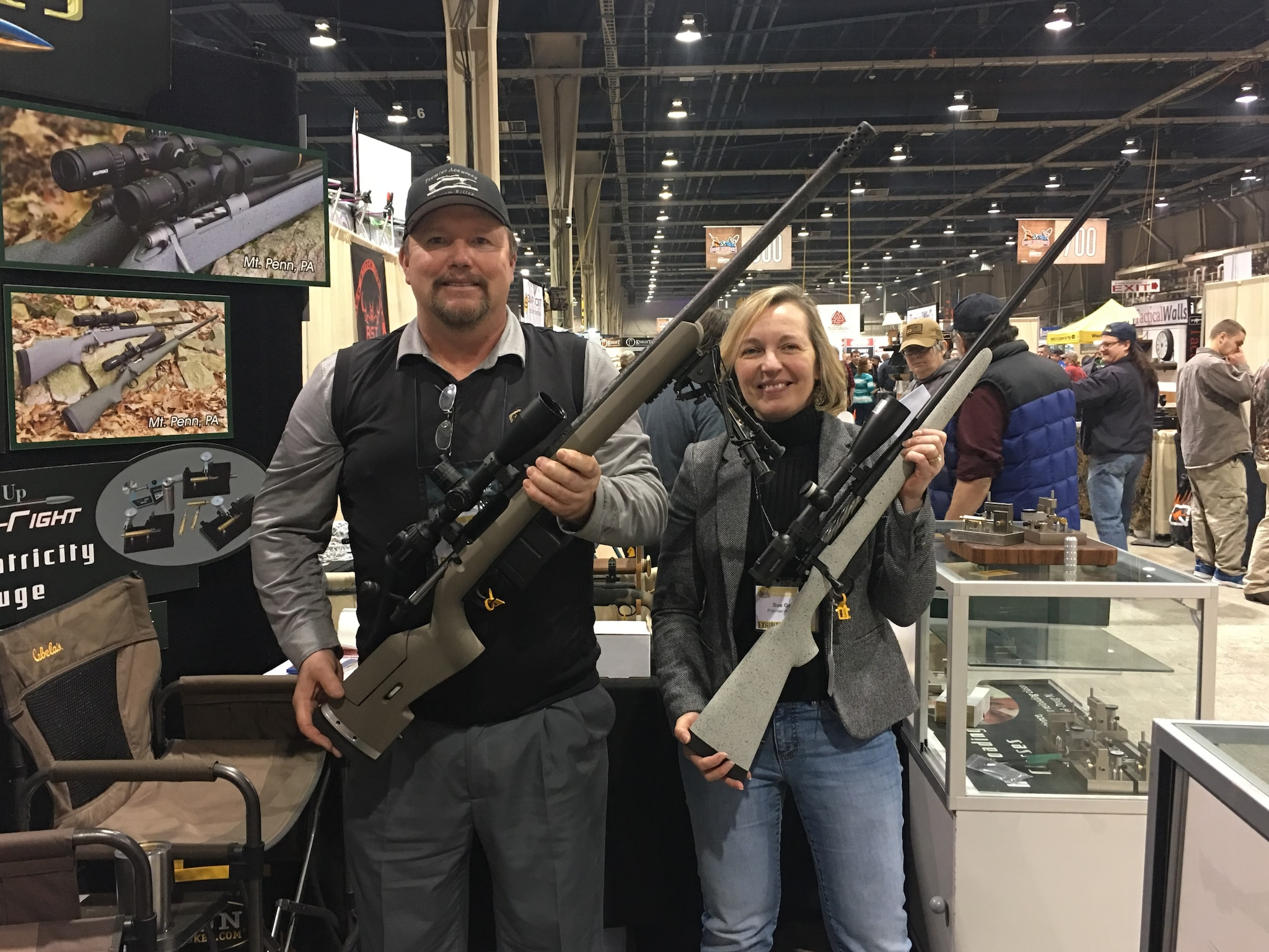 "Bill Goad and his wife, Sue, pose with some of Premier Accuracy's custom-built rifles. Goad says prices range from $1,200 ""tune ups"" on existing rifles to $7,000 custom builds. (Photo: Christen Smith/Guns.com)"