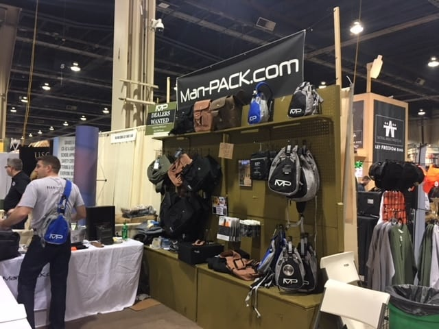 Aaron Tweedie, left, models the latest Man-PACK design at the 2018 Great American Outdoor Show. (Photo: Christen Smith/Guns.com)