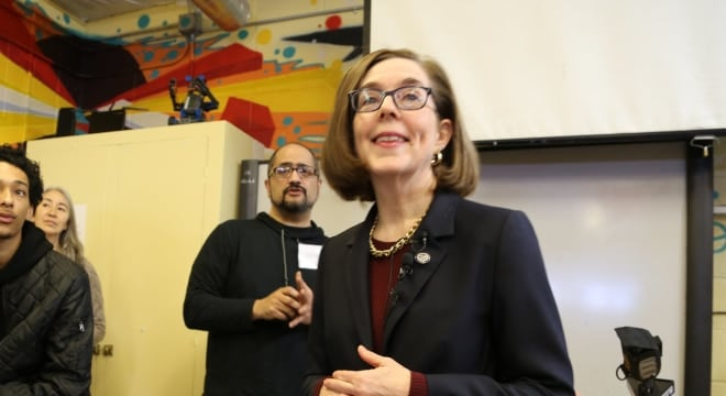 Legislation headed to Oregon Gov. Kate Brown, right, would mean more gun rights are removed from more people in domestic violence and stalking situations (Photo: Gov. Brown's office)