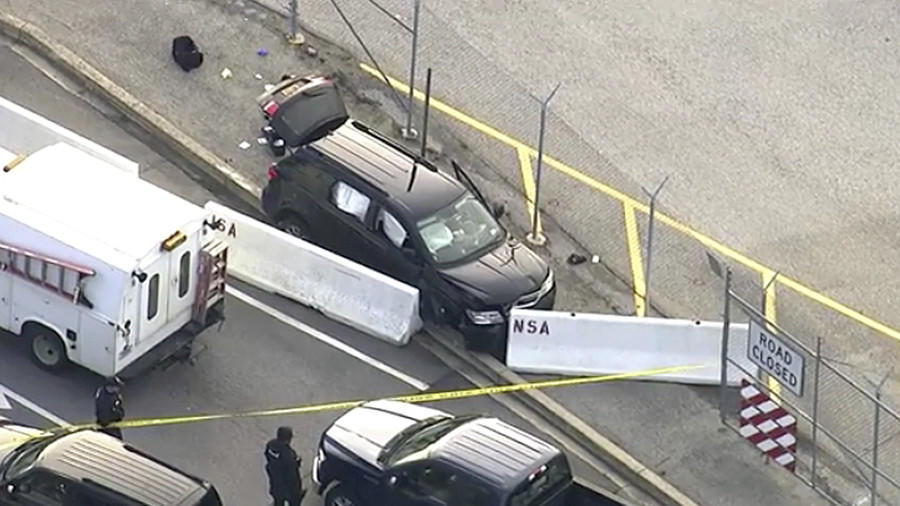 In this image made from video and provided by WUSA TV-9, authorities investigate the scene of a shooting at Fort Meade, Md. on Wednesday, Feb. 14, 2018. (AP)