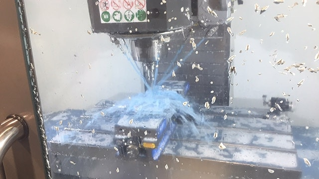 A block of 7075 aluminum becomes a finished bullpup frame in 30 minutes, thanks to laser-operating robot and some water. (Photo: Eve Flanigan)