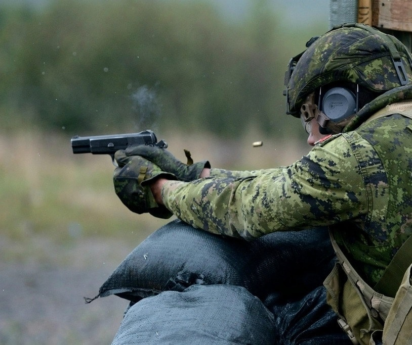 Canadian military special forces member with Inglis-Browning Hi Power 9mm (Photo: Canadian Forces)