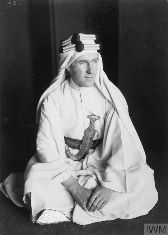 T E LAWRENCE 1888-1935 (Q 73535) Lawrence in Arab dress seated on the ground. Copyright: © IWM. Original Source: https://www.iwm.org.uk/collections/item/object/205022240