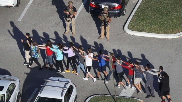 People are brought out of the Marjory Stoneman Douglas High School after a shooting at the school on Feb. 14, 2018 in Parkland, Florida. (Photo: Joe Raedle/Getty Images)