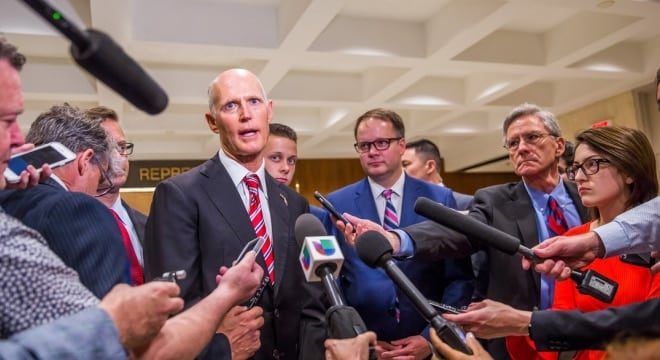 Florida's Republican Gov. Rick Scott signed a sweeping school security and gun control plan into law Friday, and the state was promptly sued by the NRA over a facet to raise the minimum age for any gun to 21. (Photo: FL Governor's office)