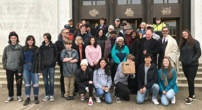 """Clergy and students dropped off 3,400 sponsor signatures with the Oregon Secretary of State on Monday in order to draft a ballot initiative to ban """"assault weapons."""" (Photo: Rabbi Michael Cahana/Facebook)"""