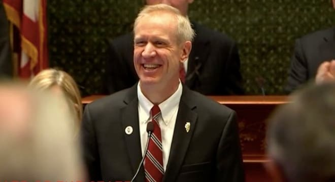 Gov. Bruce Rauner dripped veto ink on a controversial measure that would have added red tape to federally licensed gun dealers in the state (Photo: Rauner's office)