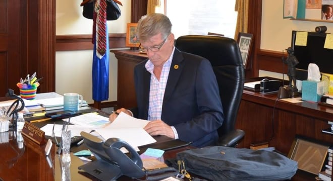 Idaho's Republican Gov. Butch Otter has been processing through a stack of legislation on his desk from this session, but took no action on a measure to enshrine SYG protections, instead allowing it to become law without his signature. (Photo: Governor's office)